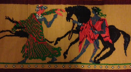 A tapestry my mum made of a gypsy woman meeting with St George