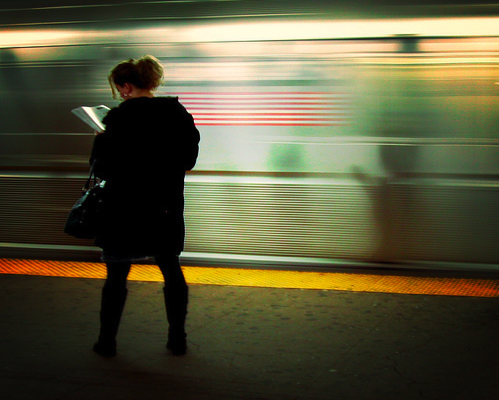 On the platform, reading Flickr user: Mo Riza/ CC by 2.0