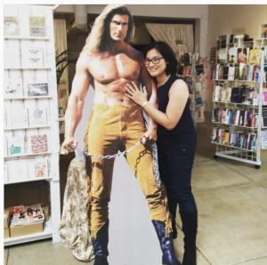 Kat Mayo hugging a Fabio cutout