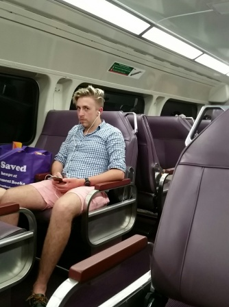 Peter sitting on a train not looking at all impressed