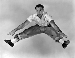 Gene Kelly dancing wearing white socks and black shoes