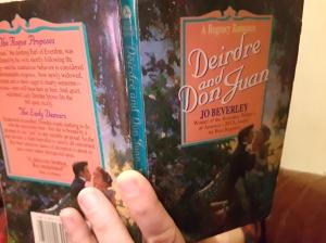 Marijana's hand holding Jo Beverley's Deidre and Don Juan